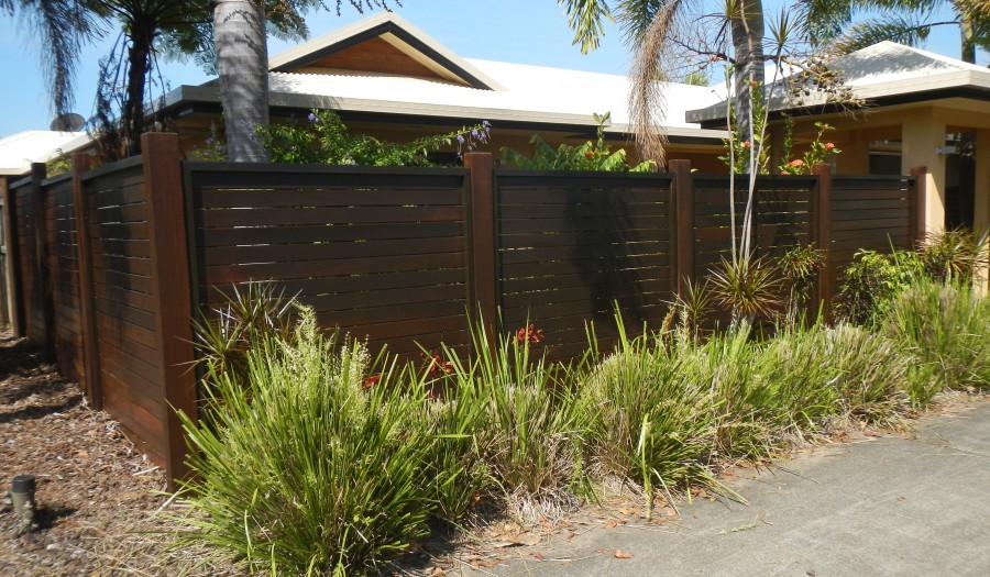 Looking like a new fence with panels replaced and fresh coat of oil